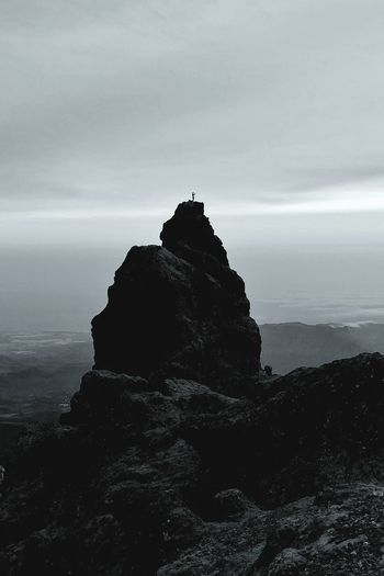 A man in a distance taking picture at the highest mountain of Canary Islands. Sea Rock - Object Beach Man Alone Top Of The Mountain EyeEm Nature Lover EyeEmNewHere Lost In The Landscape