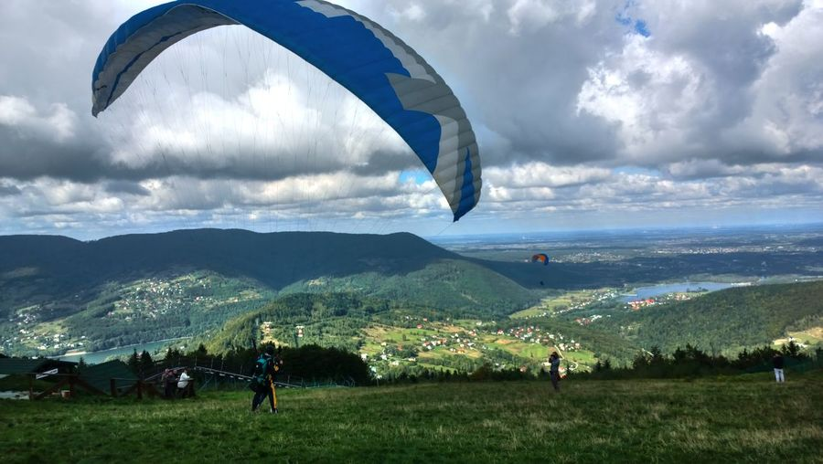 People doing paragliding