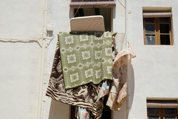 Low angle view of quilts on balcony