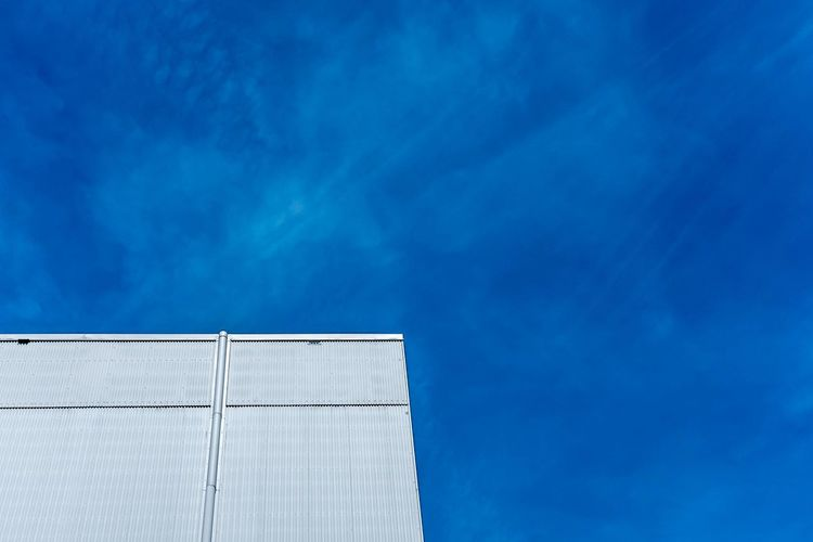 Low angle view of theatre building against blue sky