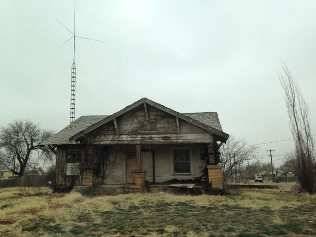 Abandoned Architecture Building Exterior Built Structure Cable Clear Sky Day Electricity  Electricity Pylon Field Fuel And Power Generation Grass House Old Outdoors Power Line  Power Supply Residential Structure Rural Scene Sky
