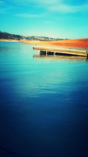 EyeEmNewHere Lonley Looking Dock Beauty In Nature Blue Sky No People Clear Lake Red Shores
