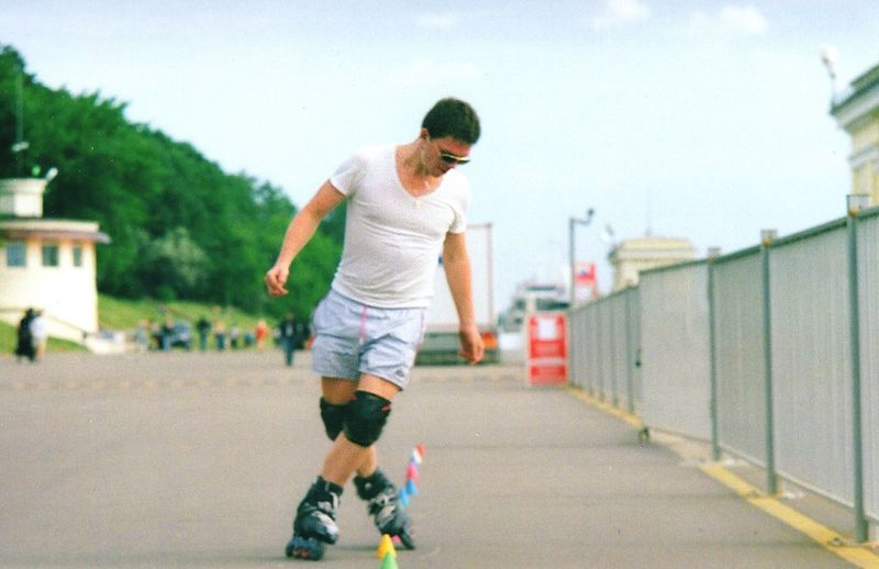 Man roller skating on road