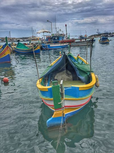 Colorful boats in Harbour Marsaxlokk, Malta Architecture Built Structure Cloud - Sky Day Harbor Mode Of Transport Moored Nature Nautical Vessel No People Outdoors Sea Sky Transportation Water Waterfront