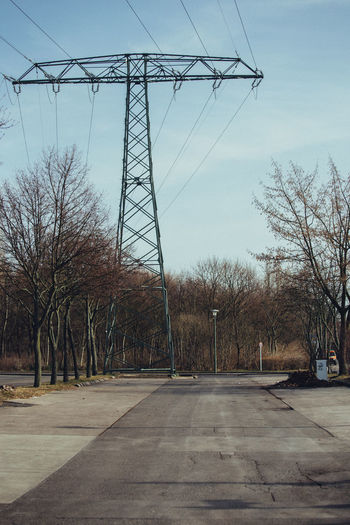 Berlin Bare Tree Berliner Ansichten Cable Clear Sky Day Electricity  Electricity Pylon Nature No People Outdoors Power Line  Power Supply Road Sky Tree