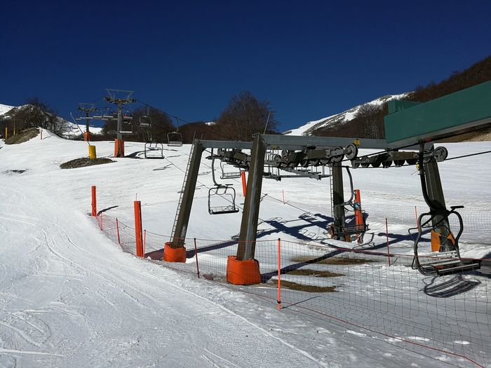 Snow Winter Cold Temperature Sky Mountain Clear Sky Nature Beauty In Nature White Color Day Covering Sunlight Field Frozen Scenics - Nature Winter Sport Tranquility Blue Snowcapped Mountain Outdoors Ski Resort  Chair Lift Roccaraso Ski Runs Ski Area