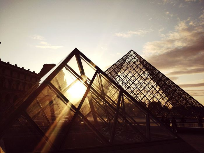 Louvre pyramid Louvre Pyramid Lights Building Exterior Louvre Museum Paris Louvre Louvremuseum City Golf Club Triangle Shape Sky Architecture Rollercoaster Amusement Park Ride Pyramid Triangle Steel Worker Traveling Carnival Building Pyramid Shape Tall Exterior