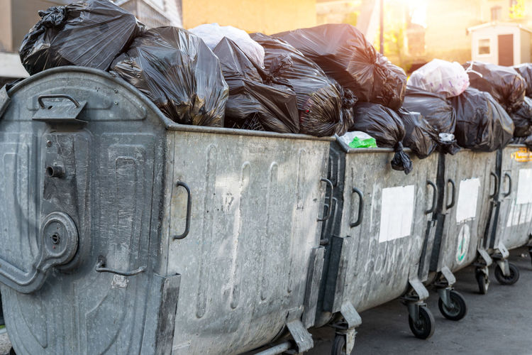 Rear view of man sleeping on garbage