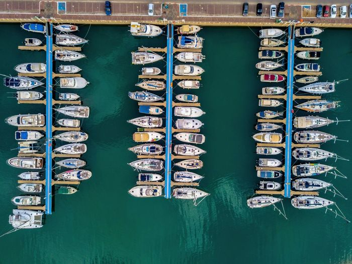 Aerial view of ships moored at harbor
