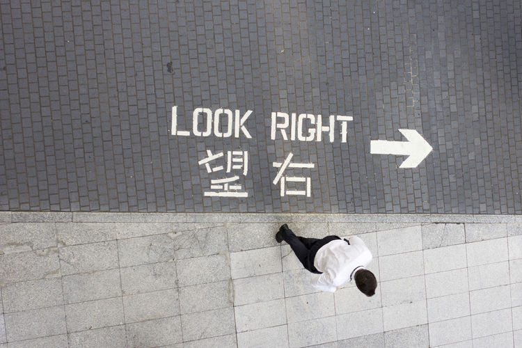 Arrow Business City Life Hong Kong Hong Kong City Mobility In Mega Cities Sidewalk Arrows Birds Eye View Businessman China Day Directions Look Right Minimal Minimalism Outdoors Pavement Right Street Street Direction Street Photography Street Sign Streetphotography Walking