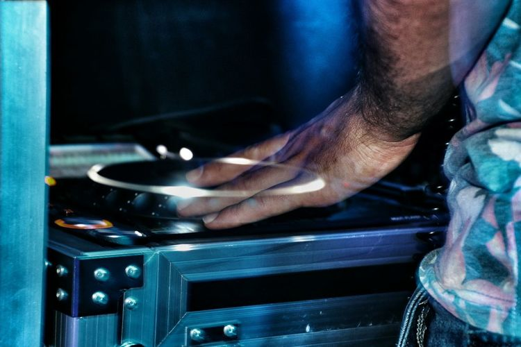 Cropped Image Of Dj Mixing Records At Turntables