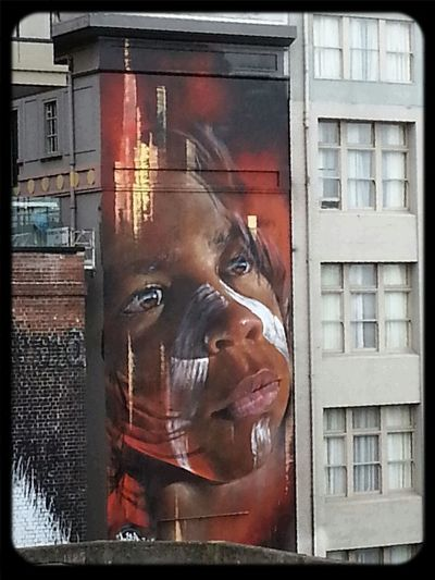 streetart on a bigger scale by Adnate from the AWOL Crew in Hosier Lane Streetart