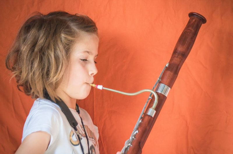 Side view portrait of a girl playing bassoon