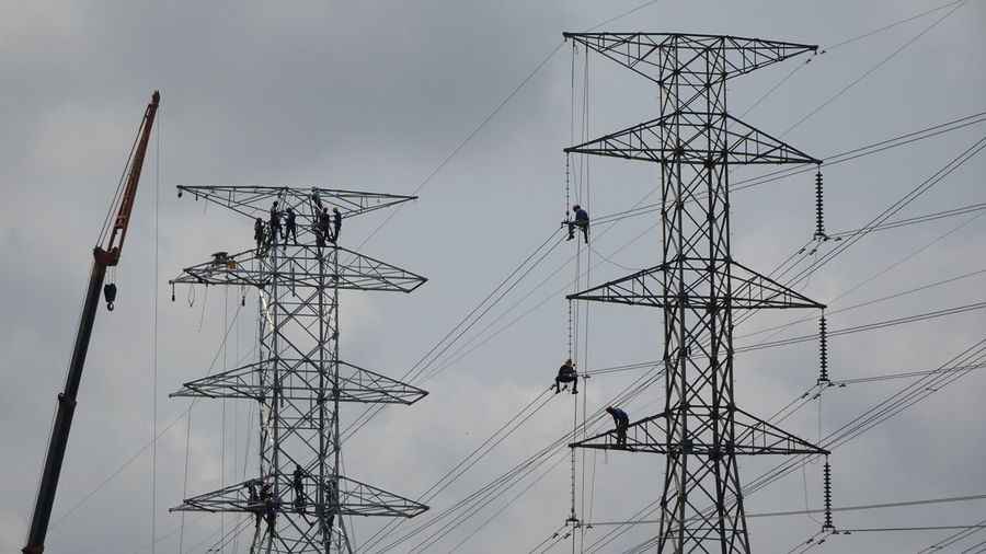 Heroic Workers on duty 70m above sea level. Golf Club Electricity Pylon Girder Global Communications Technology Steel Symmetry Electricity  Fuel And Power Generation Silhouette High Voltage Sign Power Cable Iron - Metal Electrical Grid Brushed Metal Sheet Metal Wrought Iron Nut - Fastener Fuse Box Bolt Corrugated Iron Radar Corrugated Power Line  Antenna - Aerial Power Line  Oxfordshire Steel Cable Power Supply Warning Symbol