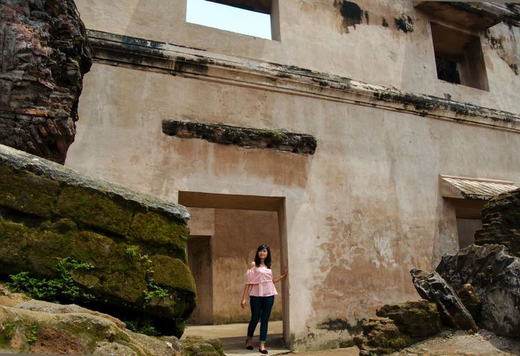 Full Length Of Woman Walking On Doorway At Taman Sari Water Castle