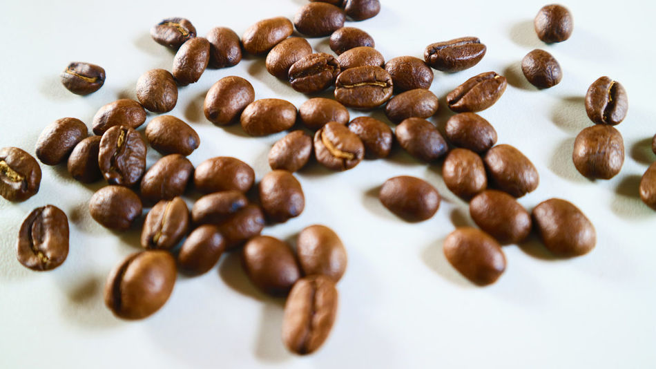 The Coffee Bean Brown Close-up Coffee - Drink Coffee Bean Coffee Cup Food Food And Drink Freshness Indoors  No People Raw Coffee Bean Roasted Roasted Coffee Bean Still Life White Background