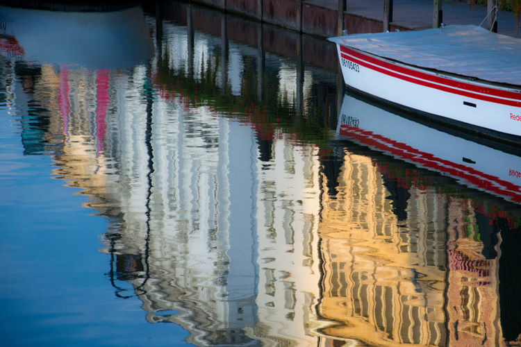 Reflection of colorful buildings in canal
