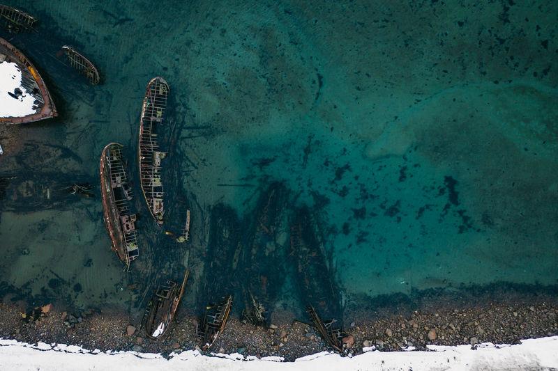 High angle view of abandoned ice on sea