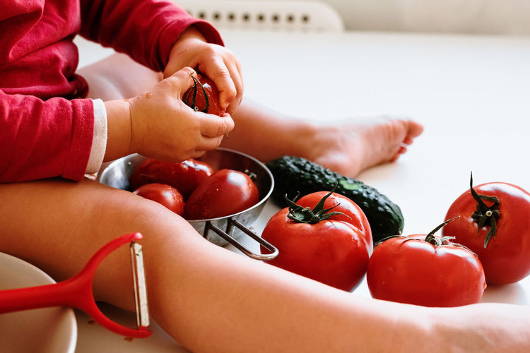 Close-up of girl holding tomatoes