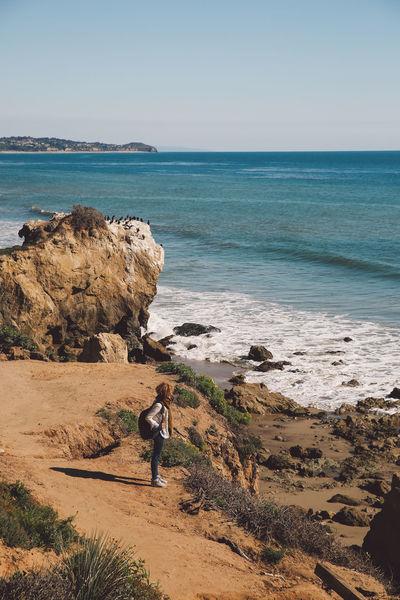 California El Matador Beach Beach Beauty In Nature Clear Sky Curly Hair Day Full Length Girl Horizon Over Water Leisure Activity Men Nature One Person Outdoors People Real People Rock - Object Sand Scenics Sea Sky Standing Water Young Adult California Dreamin