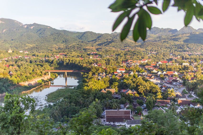 Top view the old city at Phousi mountain in Luang prabang, Laos Luang Prabang, Laos Luangprabang Mountain View Phousi Mountain Phusi Hill, Lao Road UNESCO World Heritage Site World Heritage Site World Heritage Building Forest Trees House Landmark Laos Landscape_photography Laos City Laos Temple Laos Travel Luang Prabang Mountains And Sky Phu Si Hill Sunset Top View Travel Laos Urban Landscape View Point