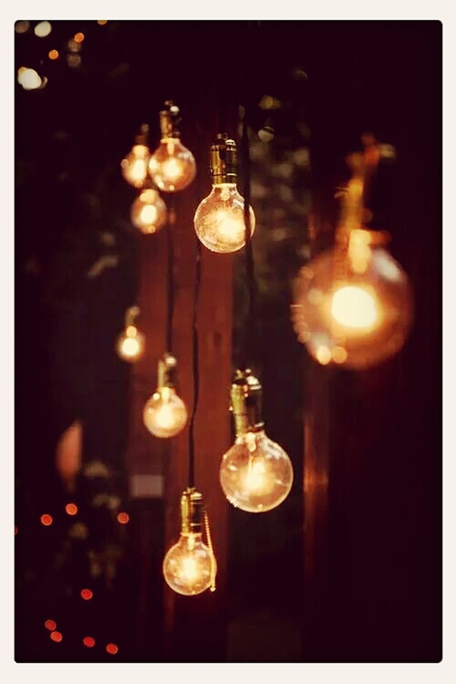 indoors, illuminated, lighting equipment, transfer print, light bulb, hanging, electricity, close-up, glowing, chandelier, auto post production filter, night, lit, light - natural phenomenon, decoration, electric light, focus on foreground, ceiling, no people, electric lamp