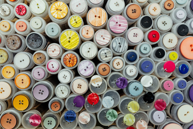 Buttons Multi Colored Large Group Of Objects Choice Variation Still Life Full Frame Backgrounds No People Indoors  Abundance Button Collection Sewing DIY Homemade Arrangement Sewing Item High Angle View Directly Above Art And Craft Plastic Stack Shape Thread Heap