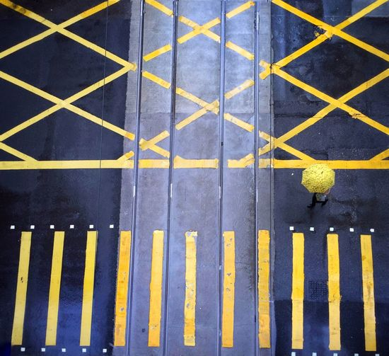 High Angle View Yellow Full Frame Repetition Blue Outdoors Geometric Shape Hong Kong Pedestrian Crossing Urban City Life Day Rainy Yellow Umbrella People Weather Pedestrian Chance Encounters Embrace Urban Life waiting game waiting game Long Goodbye The Street Photographer The Street Photographer - 2017 EyeEm Awards Paint The Town Yellow