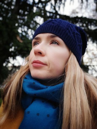 Close-up of woman wearing knit hat