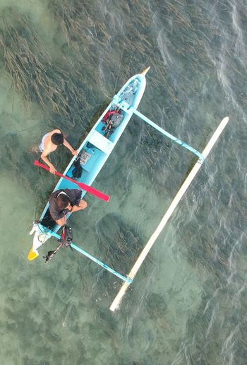 Getting ready to go! Bali Drone Photography Indonesia Drone Photography Hobby Boats And Water Wooden Boat Travel Nautical Vessel Beach Paradise Water Sport Fun Lifestyles Beach Life Paradise Bali Sanur INDONESIA Summer Holiday Vacations Water Men Full Length High Angle View Aerial View Water Sport Oar Canoe Outrigger Rowing Focus On The Story Going Remote