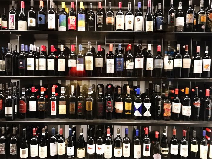 Bottle Shelf Wine Bottle Large Group Of Objects In A Row Alcohol Wine Abundance Drink Variation Choice Indoors  Liquor Store Arrangement Full Frame Wine Rack No People Backgrounds Day Close-up