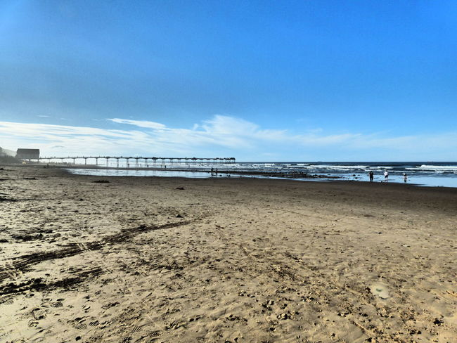 Saltburn Beach Beach Sand Blue Sea Water Shore Tranquil Scene Sky Tranquility Scenics Horizon Over Water Sunny Day Beauty In Nature Outdoors Nature Non-urban Scene Sandy Vacations Coastline Showcase August 2016 Waterfront Clear Sky Tranquility Tourism