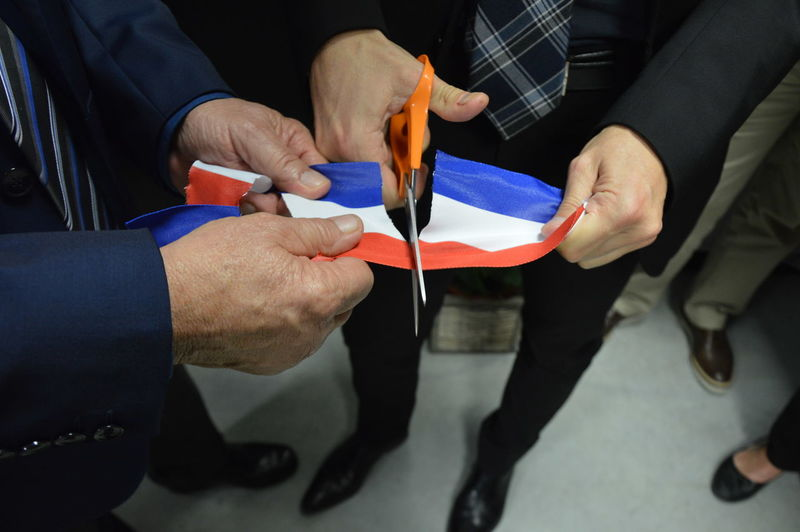 Low section of people cutting thai flag