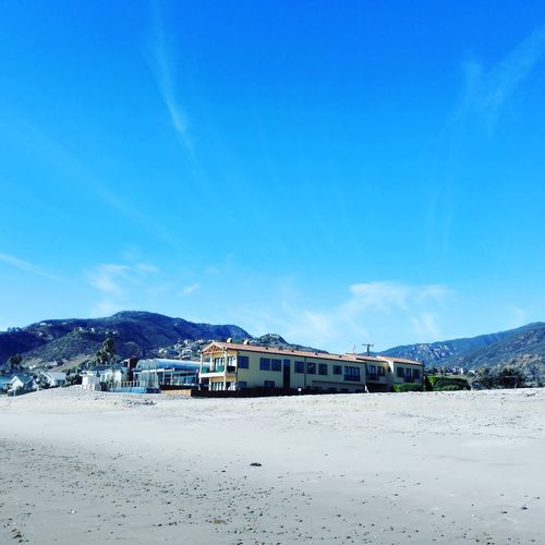 Blue Water Sky Sea Sand Beach Outdoors Vacations Summer Cloud - Sky Swimming Pool Mountain Range Building Exterior Built Structure Nature Swimming Day Scenics No People Landscape Malibu Beach Malibu Zuma Beach California California Coast