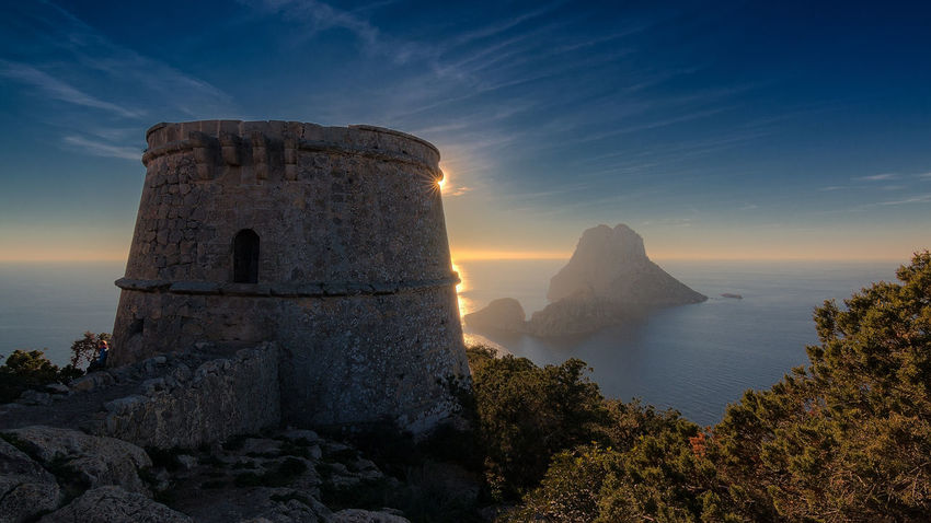 Pirate Tower on Ibiza with view to the mysterious beautiful Es Vedra Island. Sunset History Sky Cloud - Sky Outdoors No People Mountain EyEmNewHere Still Life Hiking Landscape Tranquility Wanderlust Nature Photography Scenics Beauty In Nature Power In Nature Nature Water EyeEm Nature Lover Motion Day Esvedra Ibiza Pirate
