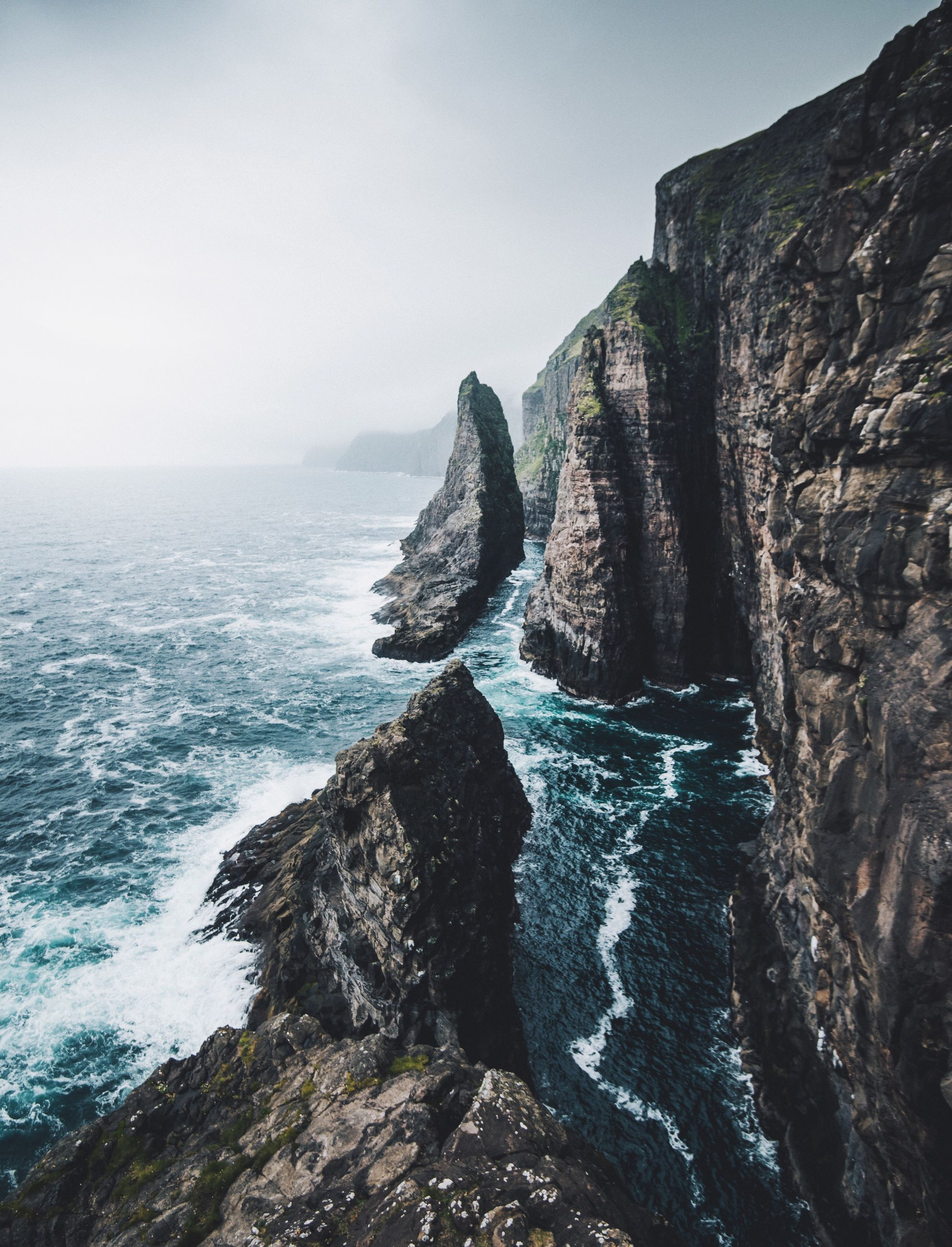 sea, rock - object, rock formation, nature, water, beauty in nature, scenics, cliff, horizon over water, tranquil scene, tranquility, sky, outdoors, day, clear sky, no people, mountain