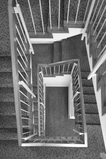 winding staircase Absence Architectural Feature Architecture Building Built Structure Ceiling Day Design Directly Above High Angle View Home Interior Indoors  No People Pattern Railing Repetition Spiral Spiral Staircase Staircase Steps And Staircases