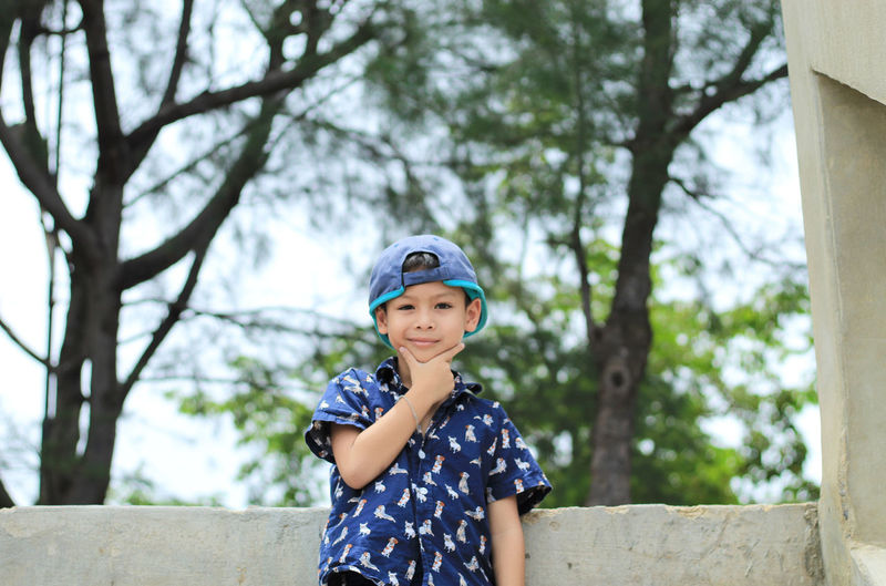 Portrait Of Boy Smiling Against Trees