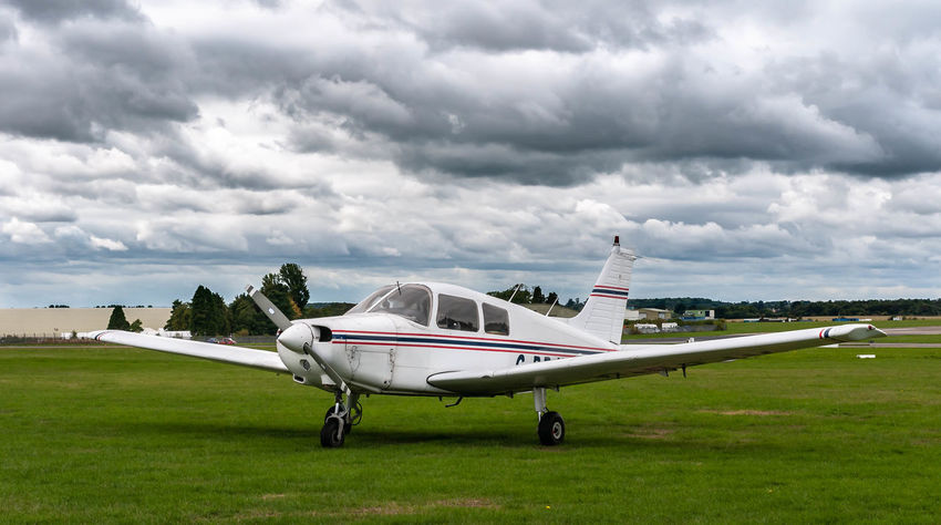 Aerospace Industry Air Vehicle Aircraft Wing Airplane Airport Airport Runway Cloud - Sky Corporate Jet Day Environment Grass Green Color Land Mode Of Transportation Nature No People Outdoors Overcast Plane Sky Transportation Travel