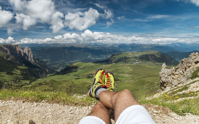 Dolomites Landscape and Cloudscape Panorama Running Shoes Relaxation Unrecognizable Person Males  Personal Perspective Mountain Human Leg Beauty In Nature Scenics - Nature Mountain Range Environment Non-urban Scene Nature Cloud - Sky Vista Panorama Outdoors Travel Adventure Day Leisure Activity One Person Body Part Sky Tranquil Scene