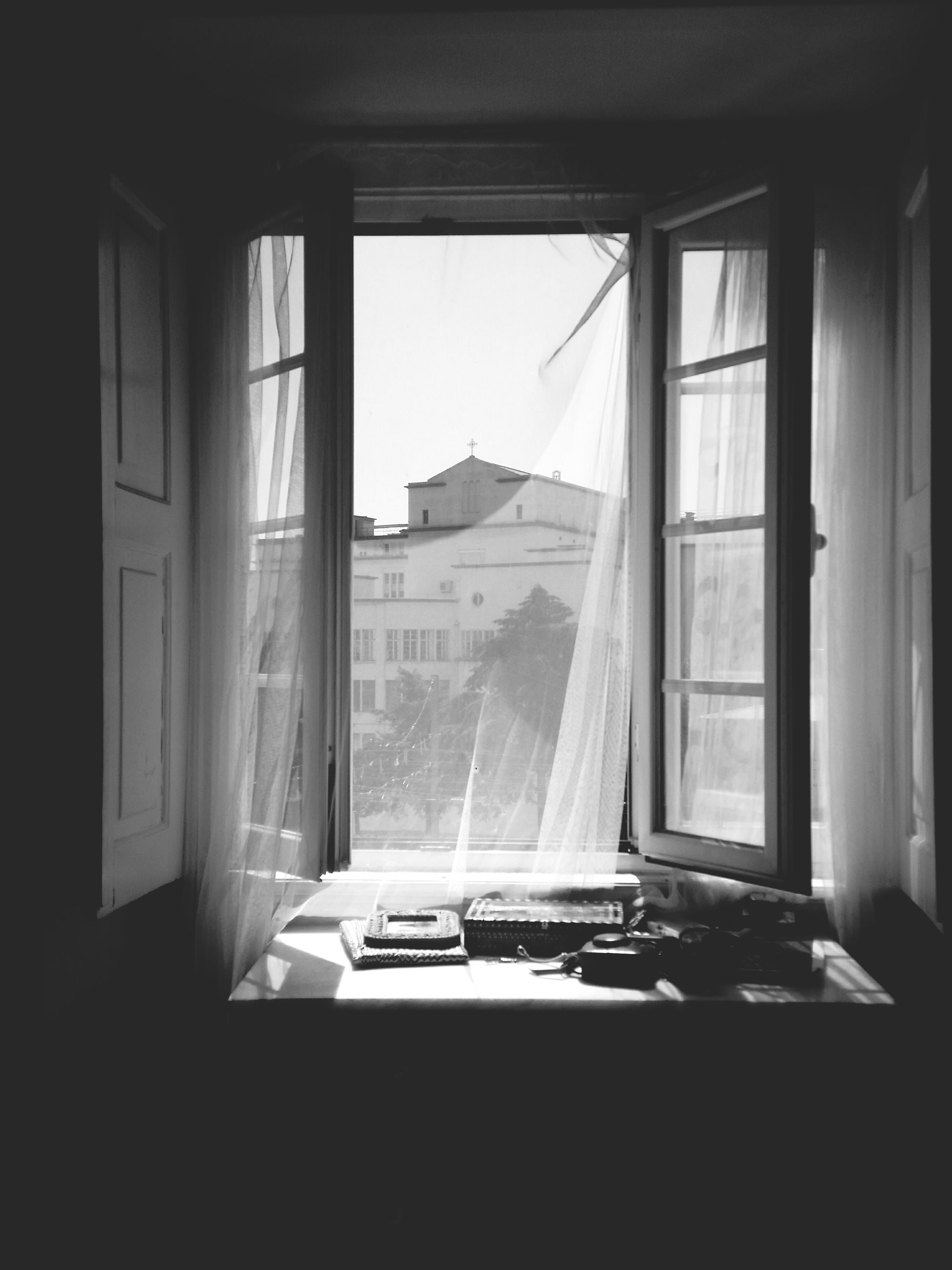 window, indoors, day, no people, transparent, glass - material, curtain, table, home interior, architecture, mountain, house, absence, building, sunlight, built structure, window frame, domestic room, open