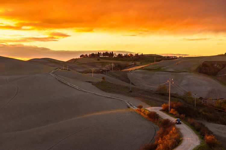 Last days of autumn Crete Senesi Torre A Castello Tuscany Tuscany Countryside Beauty In Nature Cloud - Sky Day Landscape Nature No People Orange Color Outdoors Road Scenics Siena Sky Sunset Tranquil Scene Tranquility Transportation Travel Destinations