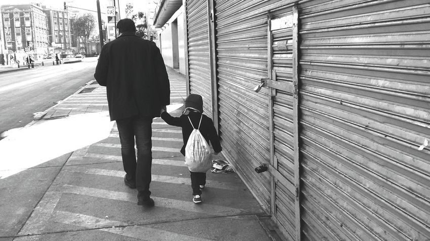 Fatherhood Moments Streetphotography Street Black Father & Son Urban View From Behind Holding Hands Winter Monochrome Photography The Street Photographer - 2017 EyeEm Awards