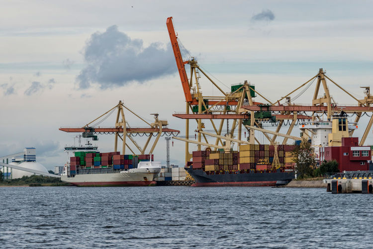 Container transshipment at port. Business Container Cranes Harbor Transport Transportation Boat Cargo Cargo Container Coal Dock Equipment Export Import Logistic Material Mine Mineral Port Sea Ship Storage Terminal Vesel