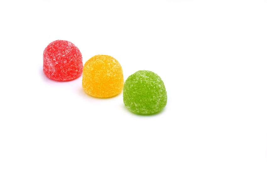 Green, yellow and red jellybean candy isolated on white background Candy Childhood Close-up Focus On Foreground Food And Drink Jellybean No People Studio Shot Sweet White Background Food Stories