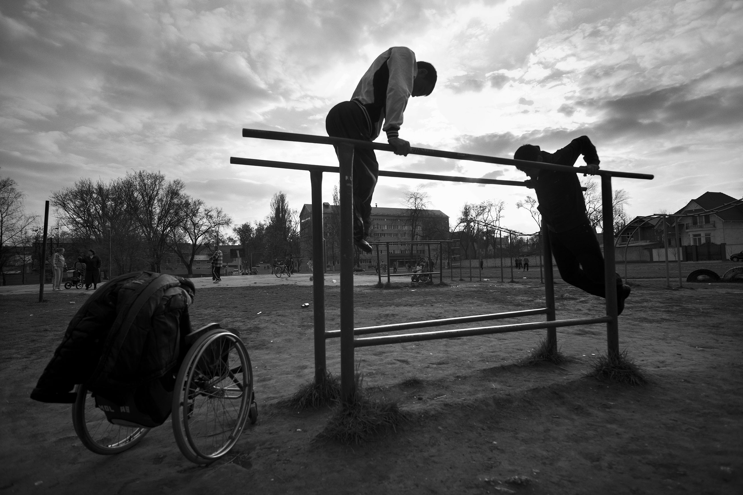 sky, cloud - sky, real people, day, men, outdoors, transportation, tree, wheelchair, full length, one person, architecture, people
