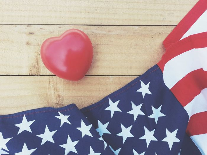 Red heart and american flag on old wood table Liberty Cheerful Greeting Celebrate Army Soldier Memory Holiday Peaceful Peace Pride Country Nation America USA Event Memorial Day 4th Of July Anniversary Independence Patriotism Flag Memorial Remember Celebration