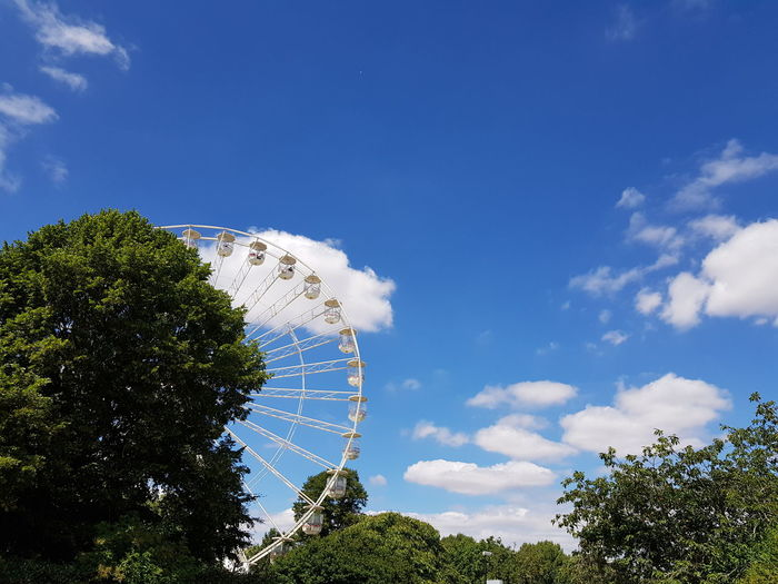 carousel against blue sky Tree Blue Sky Cloud - Sky Amusement Park Ride Carousel