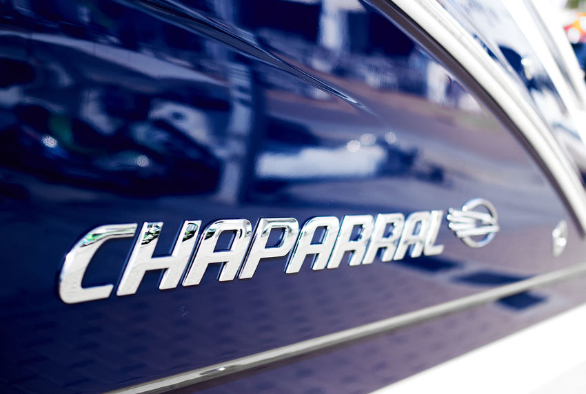 Ibiza Island, Spain - April 30, 2018: Silver logo Chaparral close-up. Chaparral has been building high quality family boats since 1965, founded in Fort Lauderdale, Florida Company Famous Fort Lauderdale  Icon International Logo Sign Boat Brand Chaparral Close-up Editorial  Editorial Photography Florida Manufacture Nautical Vessel No People Nobody Popular Silver Colored Symbol Text Transportation Watercraft Watersports