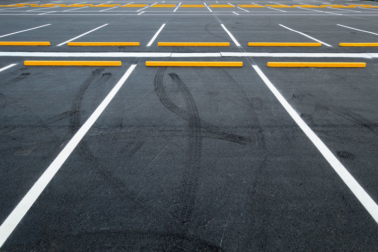 Car parking lot Architecture Dark Exterior Lines Parking Lot Asphalt Competition Day High Angle View Lot No People Outdoors Public Road Road Marking Sports Race Sports Track Stopper Transportation Vehicle